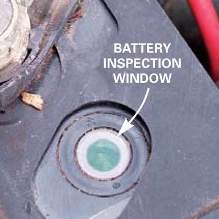 <b>No-maintenance battery</b></br> If you have a no-maintenance battery, check to see if you have a green dot in the sight glass/charge indicator. Green means the battery is good. If it's dark, it needs recharging. If it's yellow or has no color at all, (inspect carefully and use a flashlight), replace the battery.