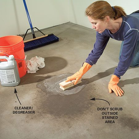 <b>Photo1: Scrub oil stains</b></br> Dip a stiff-bristle brush into a cleaner/degreaser and scrub oil stains aggressively. Wipe up with cotton rags or paper shop towels. Repeat the procedure until the greasy feel is gone and water droplets no longer bead up on the surface.