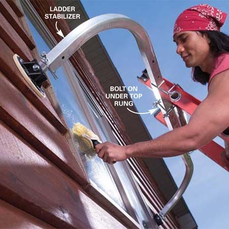 <b>Photo 3: Add a ladder stabilizer</b></br> Add a ladder stabilizer accessory to the top of your ladder to span windows and to provide extra stability. Follow the stabilizer installation instructions carefully.