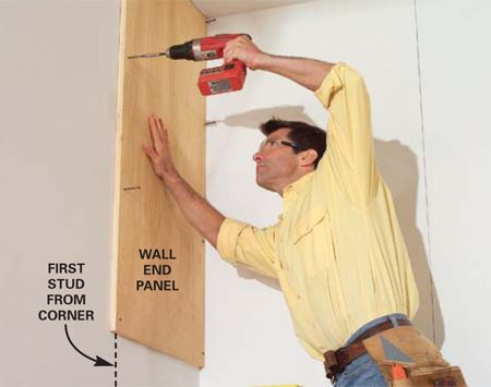 <b>Photo 2: Fasten the end panel</b></br> Press one end panel against the ceiling and the rear wall and screw it to the corner and first wall stud. Angle the back screws slightly to catch the corner stud.