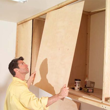<b>Photo 15: Insert finger pulls</b></br> Test-fit all the doors and slide them to the closed position. Mark the best finger pull placement. Then drill 3/4-in. holes and press in the finger pulls. (A dab of polyurethane glue will keep them from popping out.)