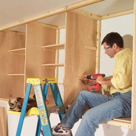<b>Photo 16:  Place shelving</b></br> Lay out shelf sizes and spacing as desired, then cut and screw 1x2 cleats to the inside of the cabinets and cut the 3/4-in. shelves to fit.