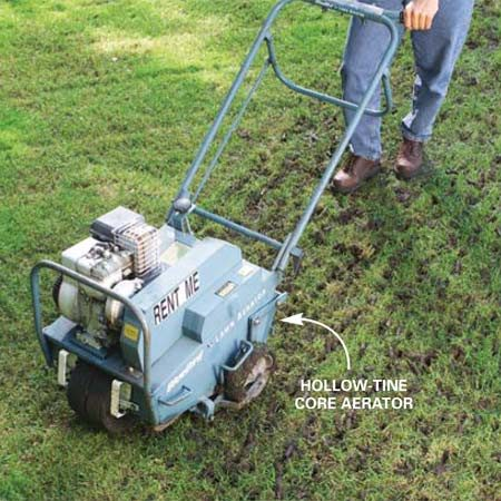<b>Photo 1: Aerate</b></br> Loosen the soil with a rented core aerator. Make four or five passes over the lawn at angles to each other. Let the cores dry a day or so before seeding.