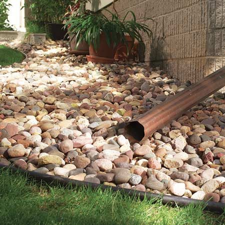 Lawn maintenance and gardening tips the family handyman - Tips using rock landscaping ...