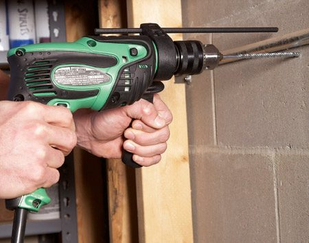 <b>Drill through concrete block</b><br/>&ldquo;If you&#39;re going to buy a corded drill, get a hammer drill,&rdquo; said Joe Jensen, set builder for <em>The Family Handyman</em> and home improvement contractor. &ldquo;It does everything a traditional drill does, but the hammering action lets you drill through tough materials faster&mdash;without burning up the bit.&rdquo; When you don&#39;t want the hammer feature, simply turn it off and use the drill like a standard one.  The model shown, the Hitachi No. FDV16VB2, costs about $80 at Lowe&#39;s or through our affiliation with <a href='http://www.amazon.com/gp/product/B00006IIOJ?ie=UTF8&tag=familhandy-20&linkCode=as2&camp=1789&creative=9325&creativeASIN=B00006IIOJ'>amazon.com</a>.