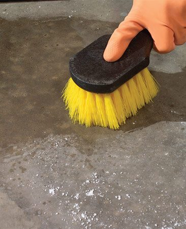 <b>Photo 4: Scrub the spot</b></br> Scrub the area with water and a nylon brush. Rinse with a garden hose.