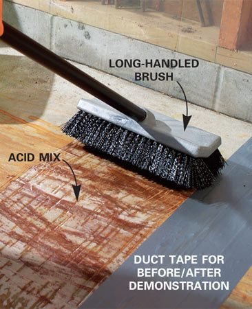 <b>Photo 2: Apply the acid with a long-handled brush</b></br> Spread the acid solution over the rusted area. Allow it to stand five minutes while the acid works. Reapply as needed, scrubbing more in stubborn areas.