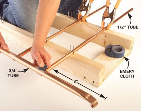 <b>Photo 6: Assemble the main frame</b></br> Place the four 30-in. tubes for the main frame in the jig with all the formed ends on the same side. Rest the 3/4-in. tube on the formed ends. Mark where the tubes intersect and sand these areas.