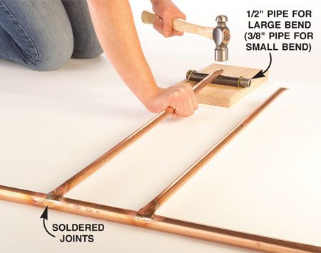 <b>Photo 9: Form the other ends</b></br> Remove the soldered tubes from the jig and flip it over on a hard surface. Form the opposite end of each tube using the same technique as shown in Photo 2.