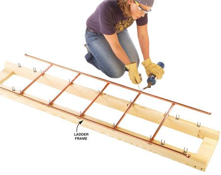 <b>Photo 11: Build the ladder frame</b></br> Solder together the ladder frame of tubes using the procedure in Photos 5 – 8. Slide tubes to one side to keep the flame away from the 2x4s.