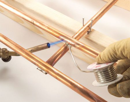 <b>Photo 13: Solder the ladder to the frame</b></br> Realign the ladder over the main frame. Clamp it in place and solder where the tubes intersect.