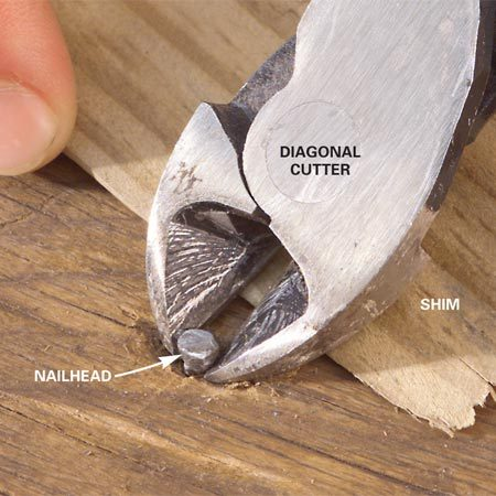 <b>Photo 1: Start with a diagonal cutter</b></br> Grab slightly protruding nails directly under the head with a diagonal cutter. Roll the cutter back onto thin blocking to pry the nail up slightly.