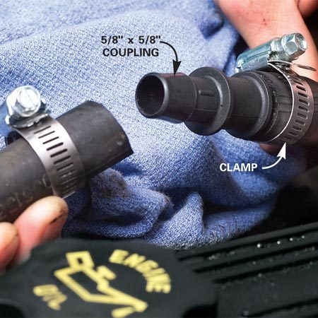 <b>Push the hose firmly onto the coupling</b></br> Apply coolant to the coupling as a lubricant. Insert one end and tighten the clamp on it. Then slip the second clamp over the hose and push the other end of the coupling into the hose.