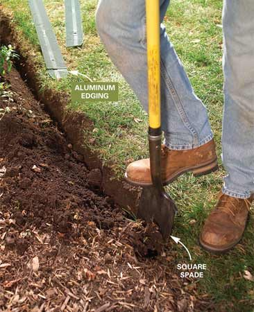 <b>Photo 1: Dig the trench </b></br> Cut a narrow, 4-in. deep trench with one vertical side along the lawn edge. Shave the vertical edge to smooth out curves. Follow a string line for straight edges.