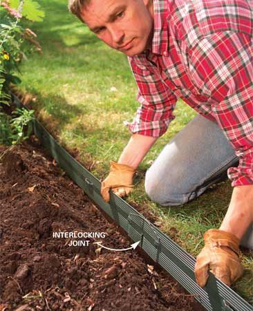 <b>Photo 2: Place the edging in the trench</b></br> Snap together the 8-ft. border sections, drop the edging into the trench and lay it against the vertical edge. Cut the final section to length with a hacksaw.