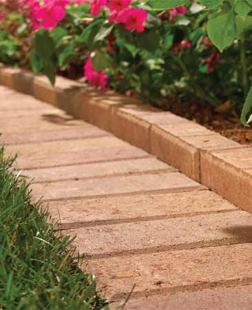 <b>Paver border</b></br> Pavers provide a wide border that keeps grass out of the garden.