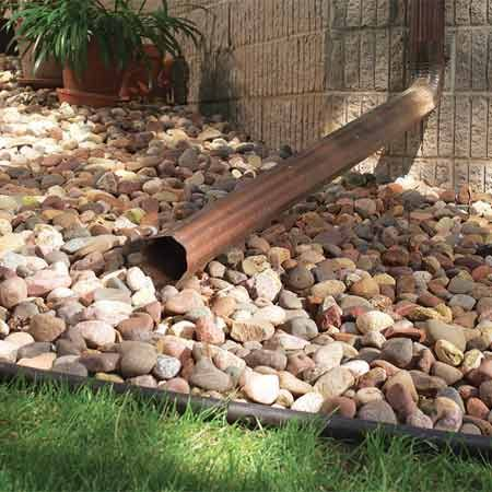 <b>Stone mulch</b></br> Stone mulch is your best choice on slopes and around downspouts because it won't wash away.