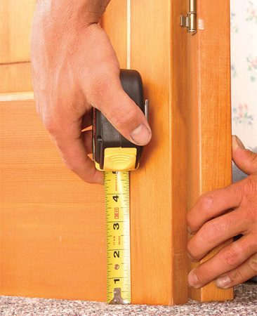 <b>Photo 1: Mark the door</b></br> Measure up 1/2 in. from the highest point on the new carpeting and mark the door.