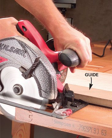 <b>Photo 4: Trim the door</b></br> Clamp a cutting guide to the door, mount a crosscut-type blade in your saw and cut slightly to the outside of the line.