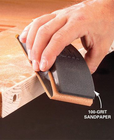 <b>Photo 5: Sand the cut edge</b></br> Knock the sharp edges off the fresh cut with sandpaper. Add a coat of sealer to the raw edge to prevent swelling. Remount the door.