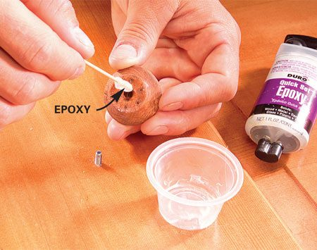 <b>Glue a loose pull</b></br> Add a drop of epoxy to repair a loose door pull. Screw it on and allow it to set for 24 hours before use.