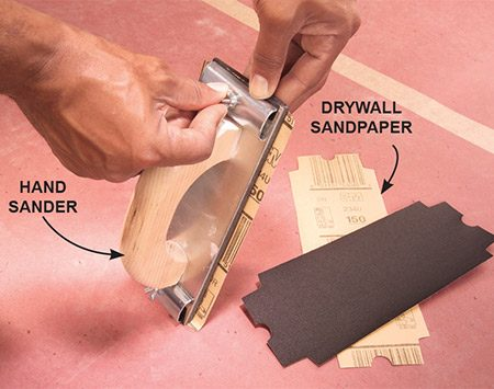 <b>Use fine grit sandpaper</b></br> Install 150-grit paper on your hand sander. Make sure it's taut by first anchoring one end under the clamp. Then push the other end under the other clamp with one hand while you tighten the clamp screw with the other.