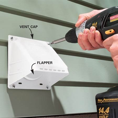 <b>Photo 6: Install the vent cap</b></br> Insert the vent and screw the cap to the house (predrill screw holes). Push foam backer rod into deep gaps, then caulk all around with acrylic caulk.