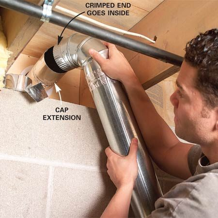 <b>Photo 11: Install the remaining vent sections</b></br> Slide the last elbow onto the straight section coming up the wall, then push the crimped end of the elbow into the duct cap section. Tape it.
