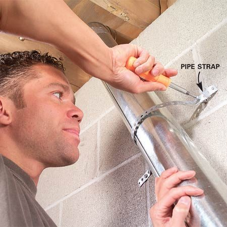 <b>Photo 12: Secure the vent to the wall with straps</b></br> Anchor the duct to walls or ceilings every 6 to 8 ft. with a pipe strap. Loop the strap around the duct; don't screw the strap to it.