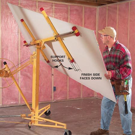 <b>Photo 1: Load the lift</b></br> Flip down the support hooks to hold the sheet. Remember: the face of the sheet goes against the lift.