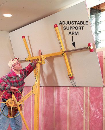 <b>Photo 2: A lift makes wall work easier </b></br> Tip the sheet against the wall. Extend the support arms to suit 8 or 12-ft. sheets.