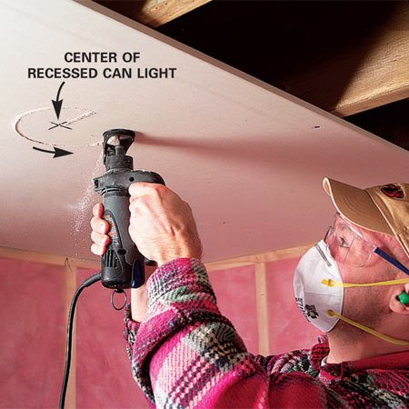 <b>Photo 3: Cut holes for ceiling lights</b></br> Run the cutout bit around the electrical box or light can. It's the fastest, neatest way to cut holes!
