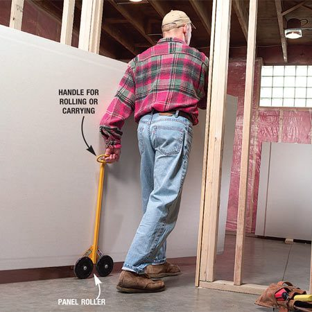<b>Photo 4: Roll your rock</b></br> A panel roller lets one guy easily move two sheets at a time.