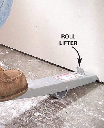 <b>Photo 9: Roll lifter</b></br> A pry bar and block of wood will do the job, but this special tool is more convenient to use