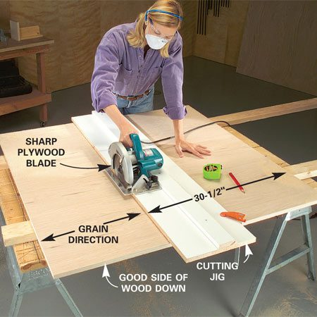 <b>Photo 1: Use a jig and circular saw to cut the shelves</b></br> Cut 3/4-in. shelf plywood to width first, using a circular saw and a homemade jig. Use a sharp plywood blade and cut with the best side of the wood facing down to minimize splintering.