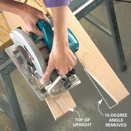 <b>Photo 3: Cut the angles in the uprights</b></br> Cut both shelf uprights to length with a miter saw. Clamp to sawhorses. Mark the 10-degree angle at the top (dimensions in Figure B), then cut with a circular saw.