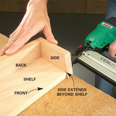 <b>Photo 7: Attach the shelf backs and sides</b></br> Glue and nail the shelf backs, then attach the sides to the plywood shelves. Position the sides to overlap the shelf base as shown.