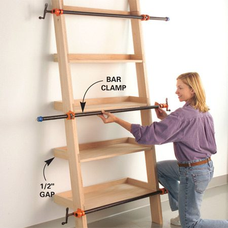 <b>Photo 9: Clamp the unit until the glue dries</b></br> Set the shelf unit against a straight wall, check for squareness and apply three bar clamps until the glue dries.