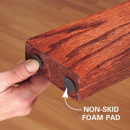 <b>Foam pad close up</b></br> Stick foam pads to the bottom of the uprights to keep the unit from moving on a slippery floor.