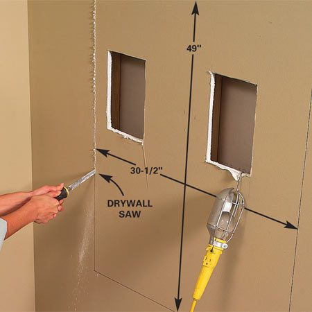 <b>Photo 2: Cut the drywall</b></br> Cut the opening to the desired height and size of your message center, following the studs with the drywall saw. Smooth ragged edges with a rasp or knife.