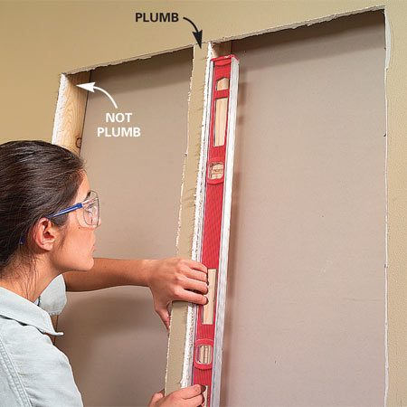 <b>Photo 3: Check for plumb</b></br> Check the studs for plumb, and adjust the width and spacing of the boxes as needed in your plan to allow them to slip in easily (Photo 10).