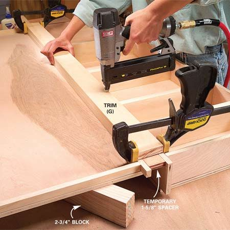 <b>Photo 7: Nail the center trim piece</b></br> Prop the shallow box even with the deeper one, space them with a 1-5/8 in. block and clamp them. Nail on the center trim (G).