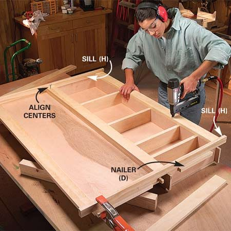 <b>Photo 8: Nail the side pieces</b></br> Center the top and bottom sills (H) and glue and nail them to the center trim. Glue and nail the side trim (G) to the sides and to the sills. Glue and nail 3/4-in. x 3/4-in. blocks to the top and bottom for nailers (D).