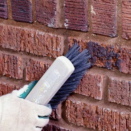 <b>Photo 8:  Clean the bricks </b></br> Sweep the loose mortar from the finished joints and brick faces using a soft-bristle brush. Mist the new mortar twice a day for two days using a hand pump sprayer or a light mist from a garden hose to help it harden.