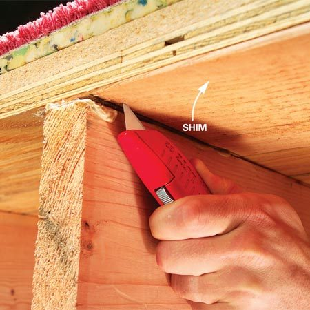 <b>Photo 3: Trim the shims</b></br> Score the excess shim two or three times with a sharp utility knife and snap it off. Keep off the floor for four hours while the adhesive hardens.