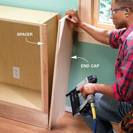 <b>Photo 5: Attach the spacers and end caps</b></br> Screw spacers to the end cabinets and nail on the end caps. Cut the end cap to fit tightly against the wall, flush with the front of the cabinets, and to stand about 2-1/8 in. taller than the cabinet.
