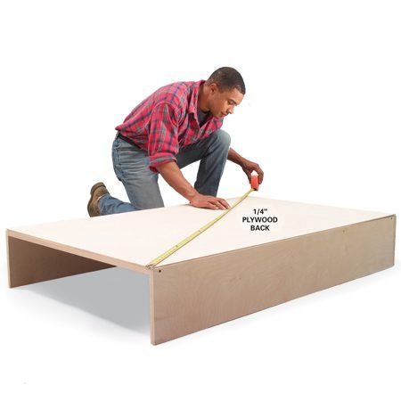 <b>Photo 7: Square the unit, then attach the back</b></br> Assemble the shelf unit sides and cleats and square the unit by measuring diagonally both ways. When the measurements are equal, the unit is square. Then nail the back into place.