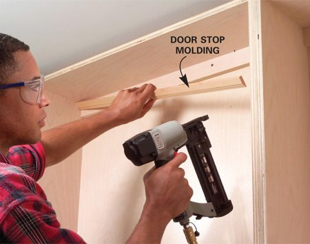 <b>Photo 10: Hide screw heads with molding</b></br> Screw the shelf units to the wall studs. Cover the screw heads with door stop molding.