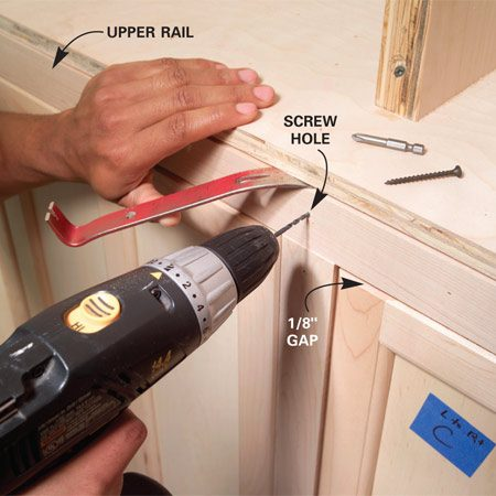 <b>Photo 16: Install the upper rail</b></br> Set the upper rail over the stiles and nail it. If brads aren't strong enough to hold a crooked rail in place, drive screws where they'll be hidden by trim later.