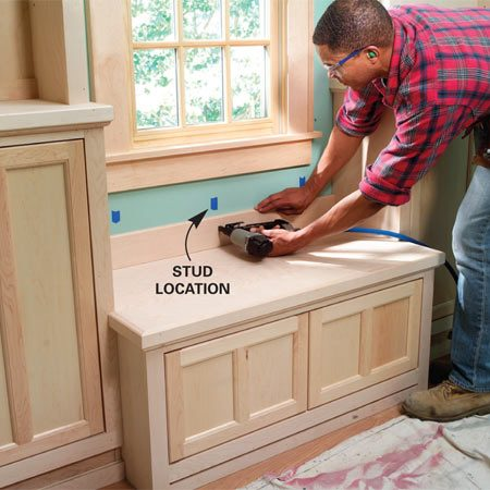 <b>Photo 22: Finish the window seat. </b></br> Add the seat top and trim. Hide any gaps around the window seat by nailing trim to the wall or adjoining cabinets. Add the baseboard (Figure A) and apply the finish to complete the project.